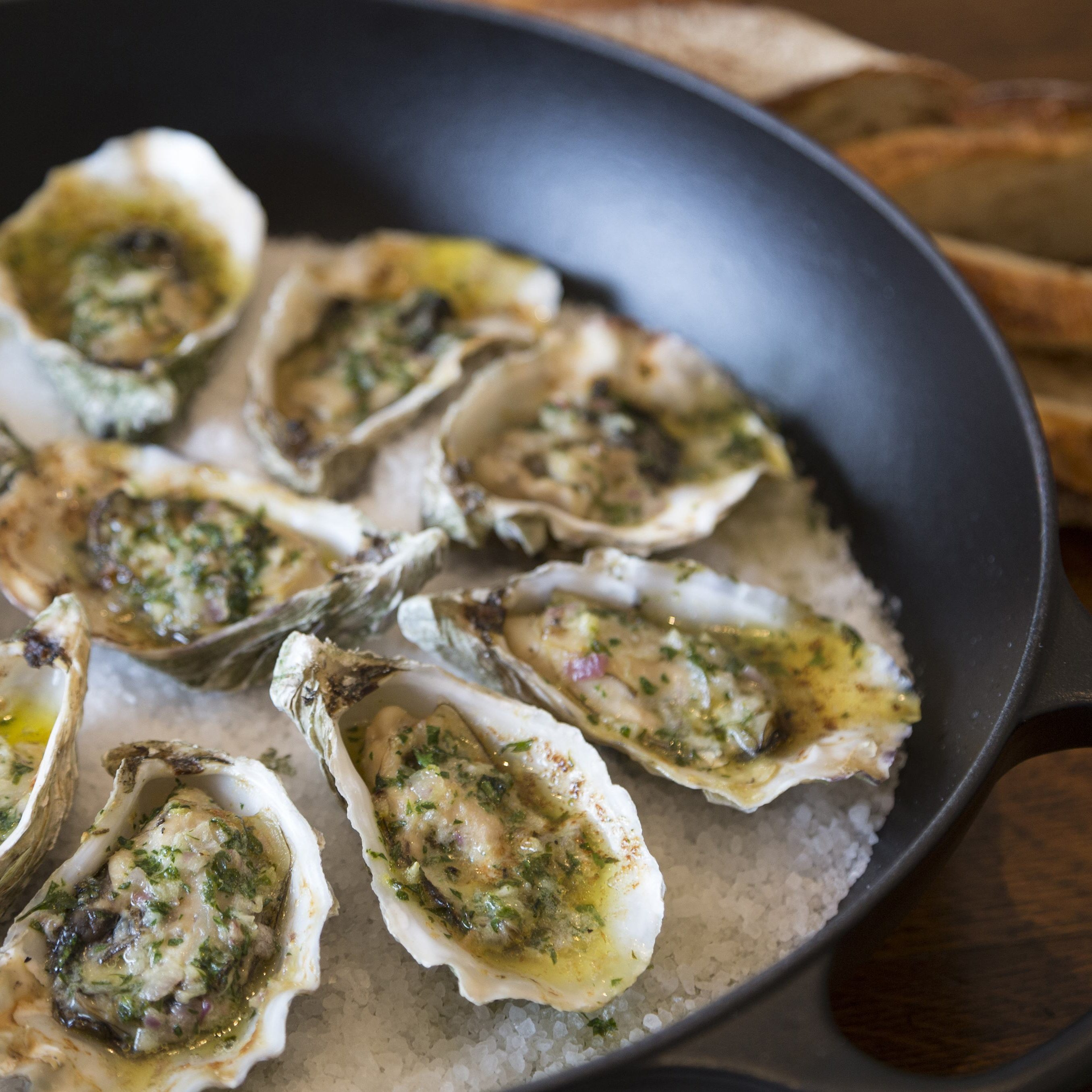 Grilled oysters with butter and garlic sauce, as prepared by host Sarah Sharratt on Cooking Channel series, UpRooted.