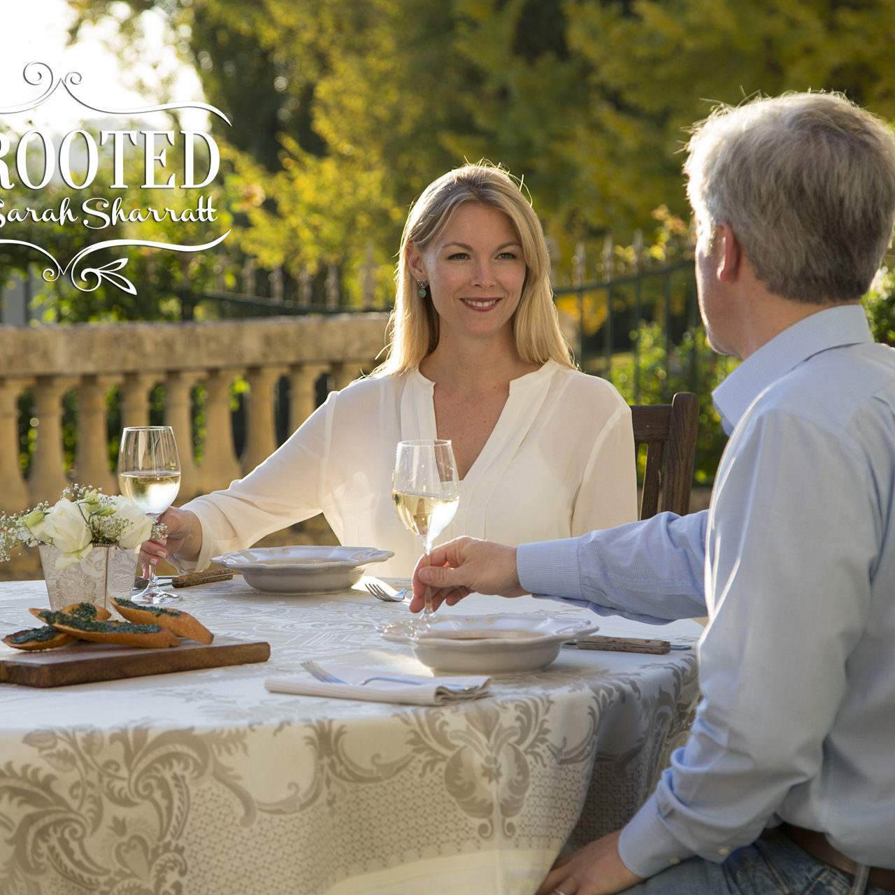 Host Sarah Sharratt and her husband Robert enjoy a romantic date night supper on the terrace of their chateau in rural France, as seen on Cooking Channel's UpRooted with Sarah Sharratt, Season 1.