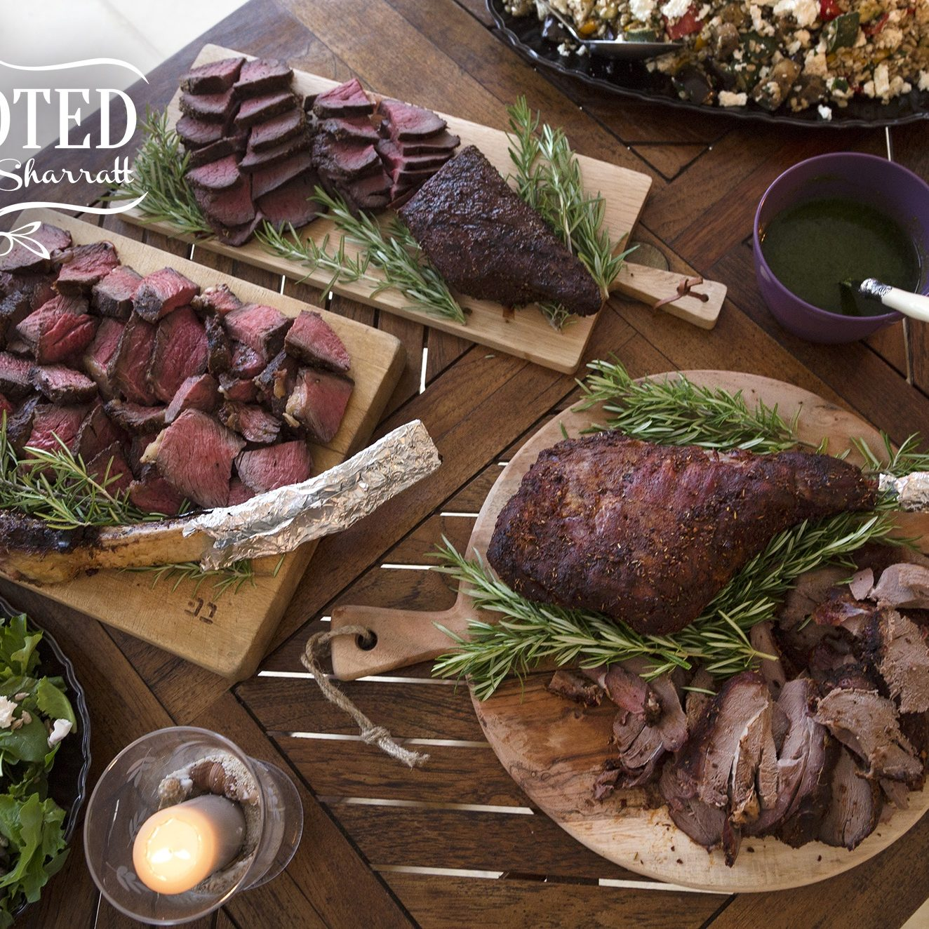 An impressive buffet of grilled meats including beef, boar and bison set out for a summer BBQ in France, as seen on Cooking Channel's UpRooted with Sarah Sharratt.